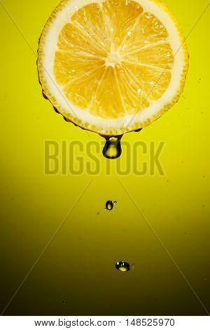 Drop of lemon juice falling down.