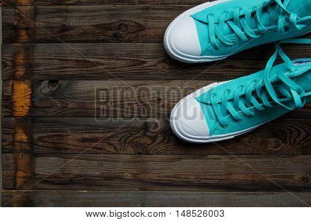 blue shoes on empty wooden parquet