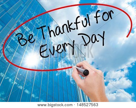 Man Hand Writing Be Thankful For Every Day   With Black Marker On Visual Screen