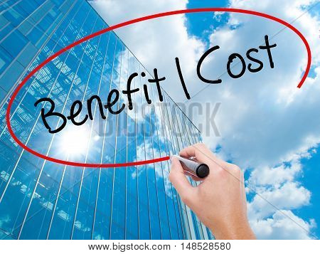Man Hand Writing Benefit Cost With Black Marker On Visual Screen