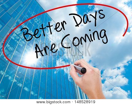 Man Hand Writing Better Days Are Coming With Black Marker On Visual Screen.