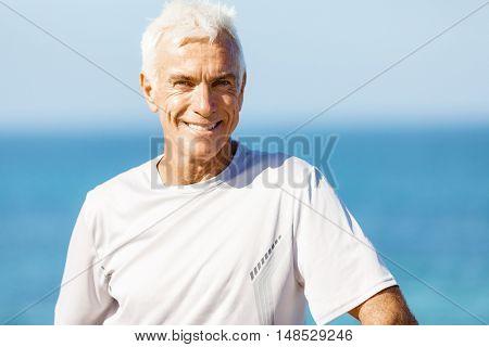 Man standing on beach in sports wear