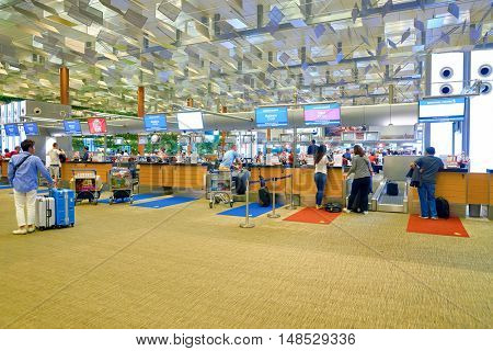 SINGAPORE - CIRCA AUGUST, 2016: check-in counters at Changi Aiport. Changi Airport is the primary civilian airport for Singapore.