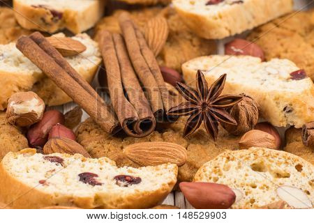 Cookies with almonds and raisins on the old wooden table. Selective focus.