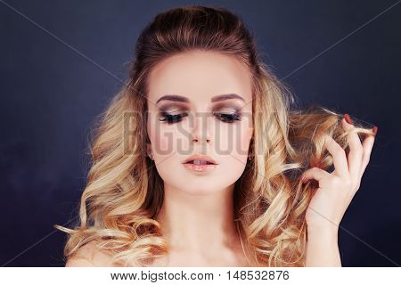 Beautiful Woman with Blonde Hair. Curly Hairstyle and Make-up