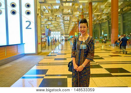 SINGAPORE - CIRCA AUGUST, 2016: indoor portrait of a woman in Changi Aiport. Changi Airport is the primary civilian airport for Singapore.