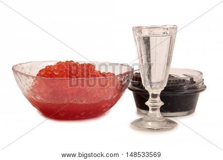 Fish caviar and glass of vodka on a white background