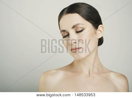 Pretty Girl With Close Eyes And Dark Eyebrows With Naked Shoulders Studio Beauty Shot