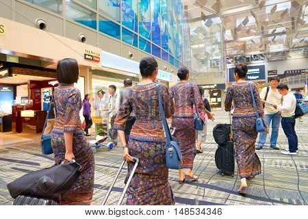 SINGAPORE - CIRCA AUGUST, 2016: Singapore Airlines crew members at Changi Aiport. Changi Airport is the primary civilian airport for Singapore.