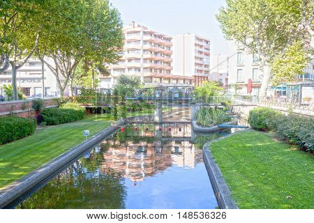 Tet River And The Reflection Of Some Buildings In Perpignan, France