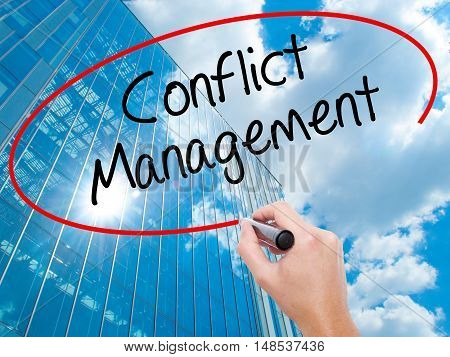 Man Hand Writing Conflict Management With Black Marker On Visual Screen.