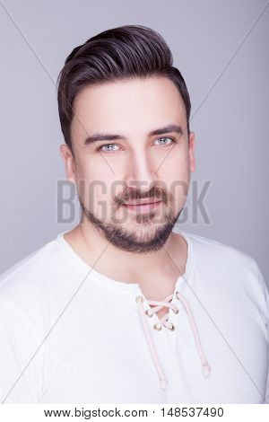 Man In Casual Clothes Smiling To The Camera