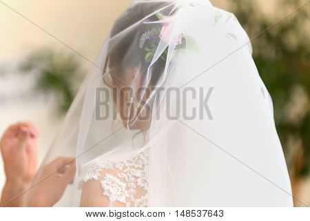 Beautiful bride with flowers and veil on head