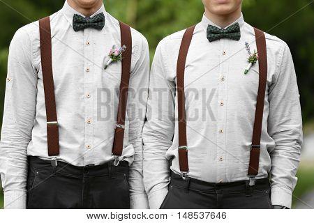 Stylish groomsmen on wedding