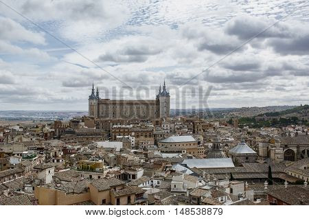 Ancient buildings under the cloudy sky in Toledo in Spain