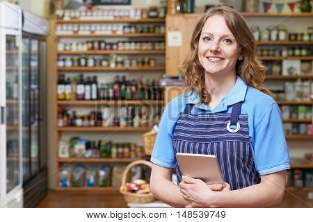 Portrait Of Delicatessen Owner With Digital Tablet