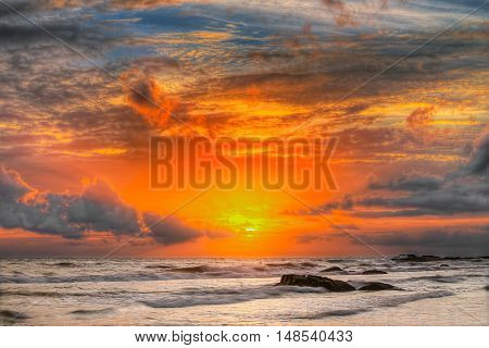 Sunset in the ocean - wide angle landscape photo of ocean waves.
