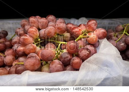 Grapes on bucket in the market .