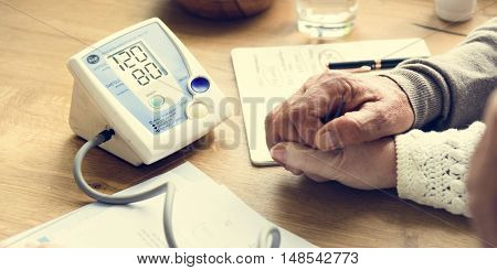 Senior Adult Measuring Blood Pressure Concept
