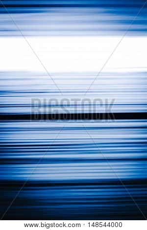 Horizontal motion blur blue and black stripes background in vertical 3:2 format.