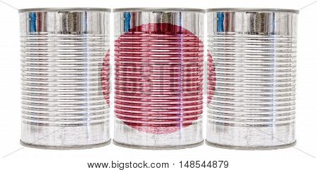 Three tin cans with the flag of Japan on them isolated on a white background.