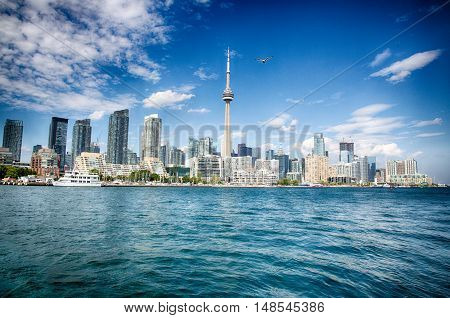 Toronto Ontario Canada August 12 2016: Toronto as seen from Lake Ontario. The city continues building as a housing boom pushes prices ever higher.