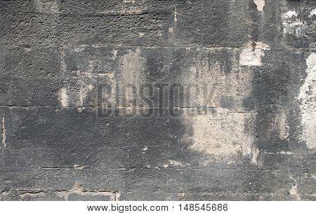 Old brick wall background. Grunge background. Sooty bricks