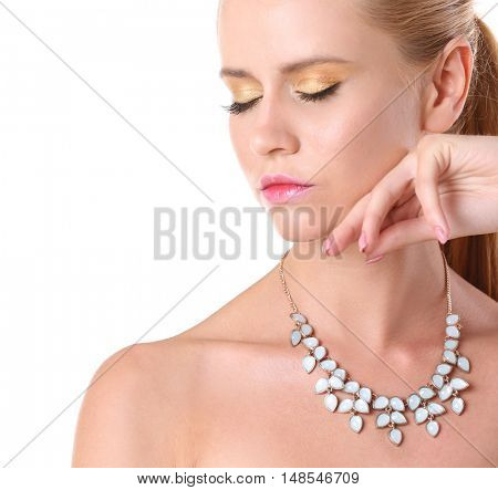 Portrait of attractive woman with beautiful necklace on her neck