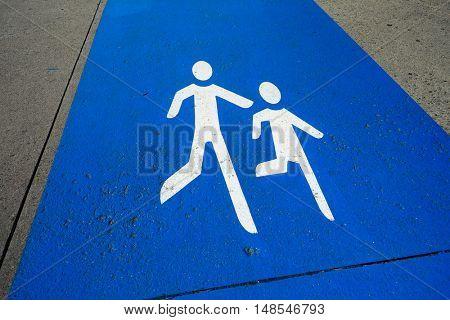 Pedestrians sign on the sidewalk
