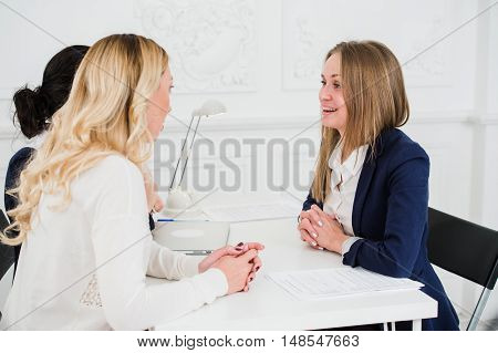 Portrait Of Happy Business People Discussing Together In Office.