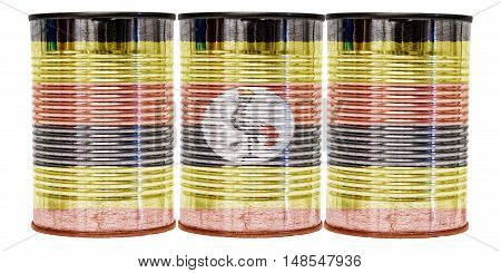 Three tin cans with the flag of Uganda on them isolated on a white background.