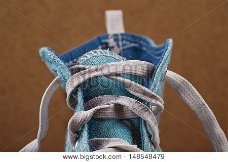 The top of a one blue sneaker without drawstring