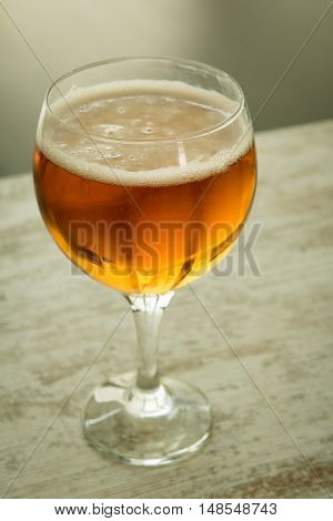 Full lager beer cup on a wooden table