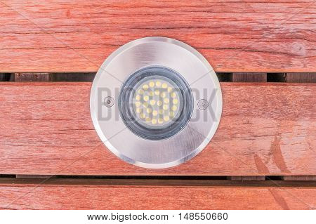 Construction details : closed up view of LED uplight installed on wooden deck