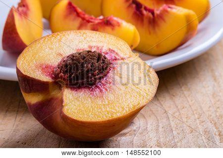Cut Peach On Wooden Table