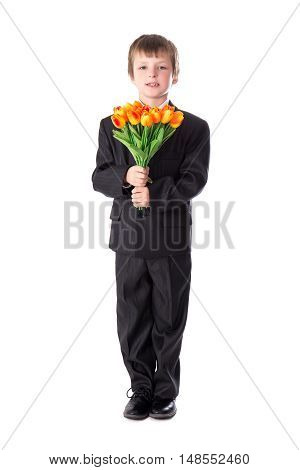 Full Length Portrait Of Little Boy In Business Suit With Flowers Isolated On White