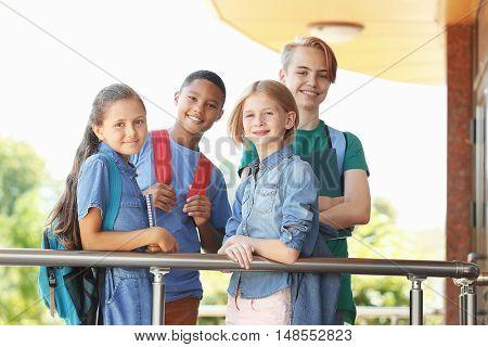 Cute kids standing on school porch