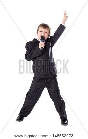 Cute Little Boy In Business Suit With Microphone Singing Isolated On White