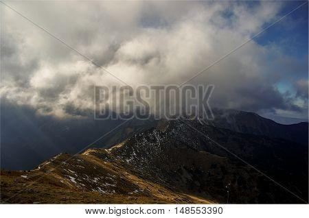 Beautiful autumn mountain landscape. Ridge under the cloud. Tatry. Poland