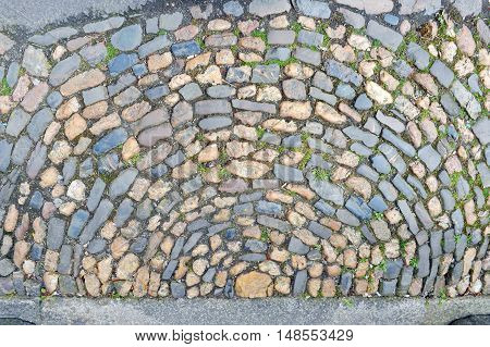 Colorful stones in pavement for a background