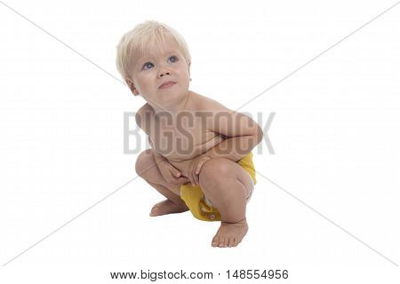 Adorable young boy with cloth diaper white background