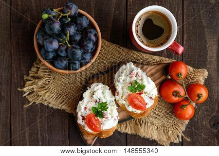 Sandwiches with pate cheese garlic slices of pepper dill. A cup of coffee. A healthy breakfast. The top view