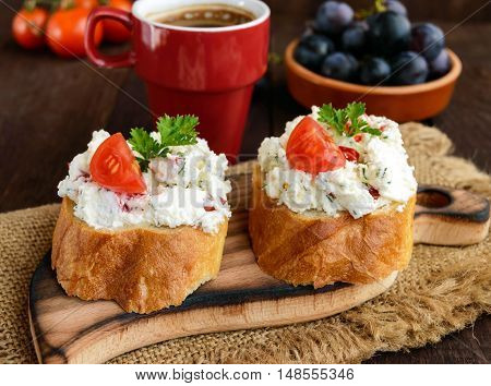 Sandwiches with pate cheese garlic slices of pepper dill. A cup of coffee. A healthy breakfast.