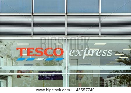 LONDON, ENGLAND - JULY 7, 2016: The exterior of an Tesco's express supermarket. Tesco's is one of the UK's leading supermarkets.