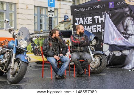 St. Petersburg, Russia - 12 August, Two bikers on the chairs,12 August, 2016. The annual International Festival of Motor Harley Davidson in St. Petersburg Ostrovsky Square.