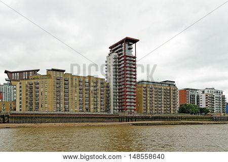 High-rise riverside residence on the Thames river on the Isle of Dogs London England.