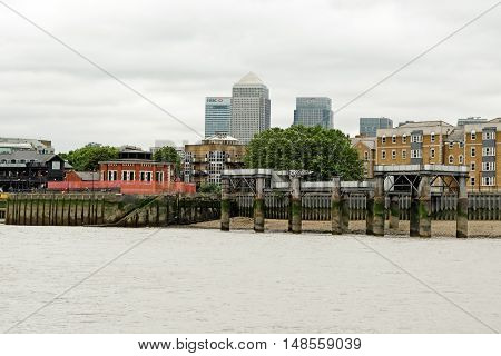 LONDON, ENGLAND - JULY 8, 2016: View towards Canary wharf - the financial heart of the city from the Rotherhithe riverside area.