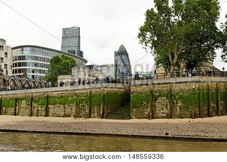 LONDON, ENGLAND - JULY 8, 2016: Thames river banks at Tower of London in the City of London.