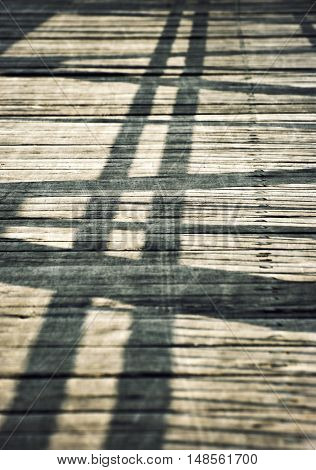 retro background Shadows on a wooden board bridge