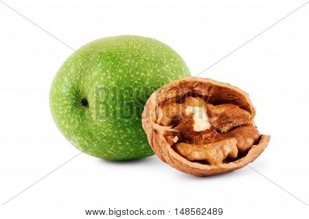 Green walnut peeled and fresh kernel on a white background